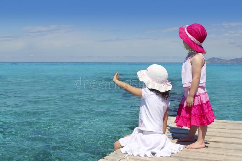 Two girls tourist turquoise sea stock photo