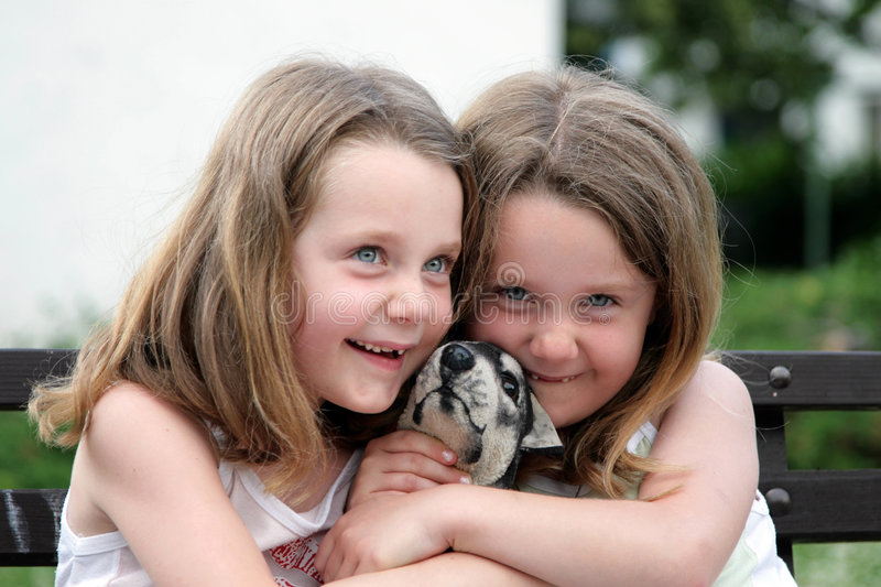 Two girls - twins. Two girls - happy twins with dog royalty free stock photography