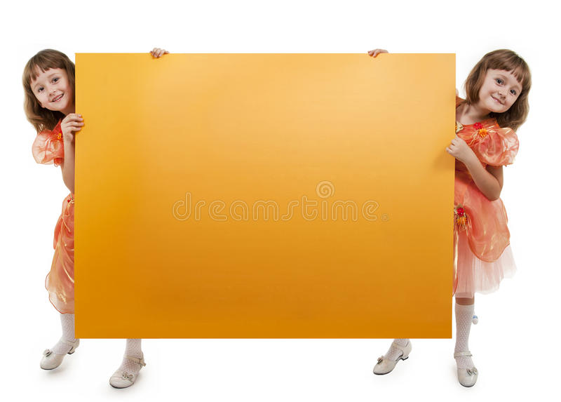 Two girls twins hold banner royalty free stock photo