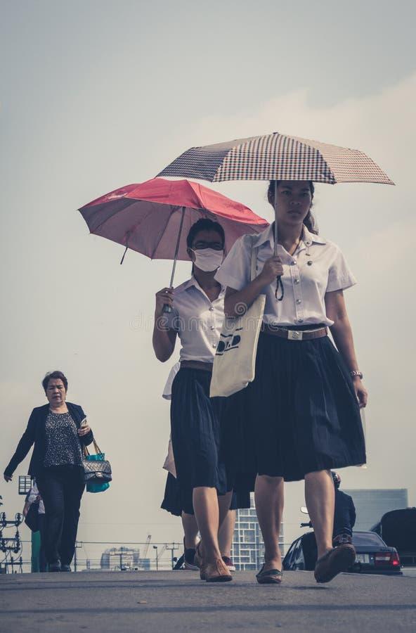 Two girls with umbrellas - street portrait, bangkok thailand stock photo