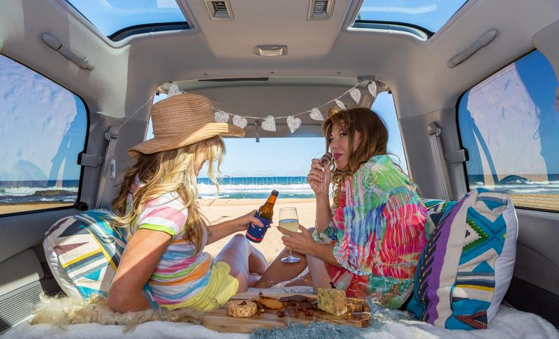 Two girls van life enjoy the beach summer stock photo