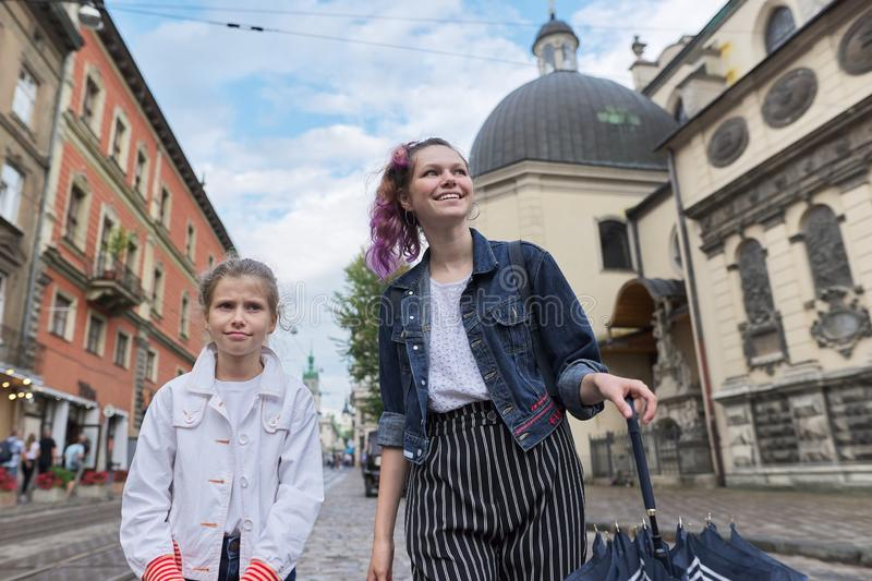Two girls walking on the street of tourist European city royalty free stock photography