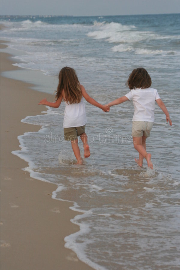Two Girls walking in the water royalty free stock photography