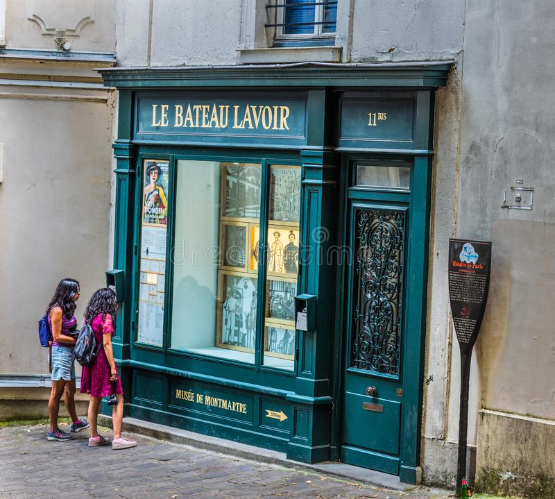 Free Two Girls Watching Historic Le Bateau Lavoir Store Window Royalty Free Stock Photo - 132185805