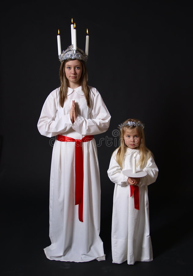 Two girls in white robes