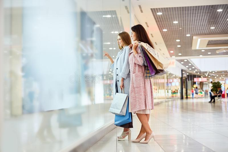 Two Girls Window Shopping in Mall royalty free stock photography