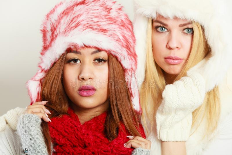 Two girls with winter outfit stock image