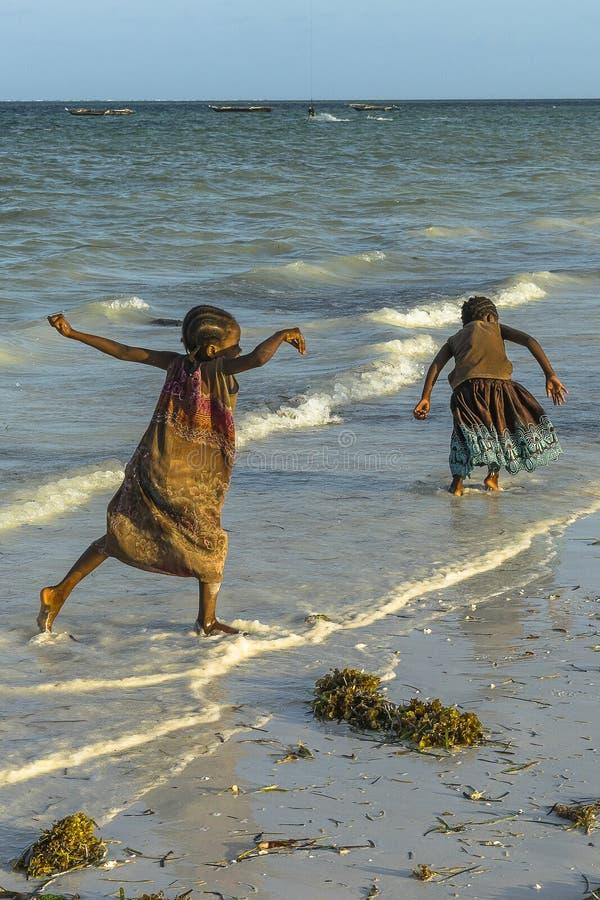 Two girls on Zanzibar beach royalty free stock photography