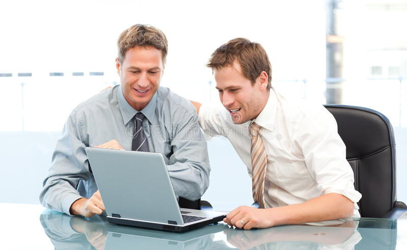 Download Two Glad Businessmen Working Together On A Laptop Stock Image - Image: 17376375
