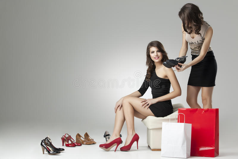 Download Two Glamorous Women Trying High Heels Stock Photo - Image: 19375152
