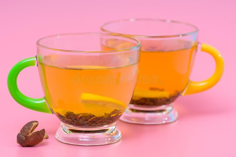 Two glass cups of spicy lemon tea or infusion royalty free stock images