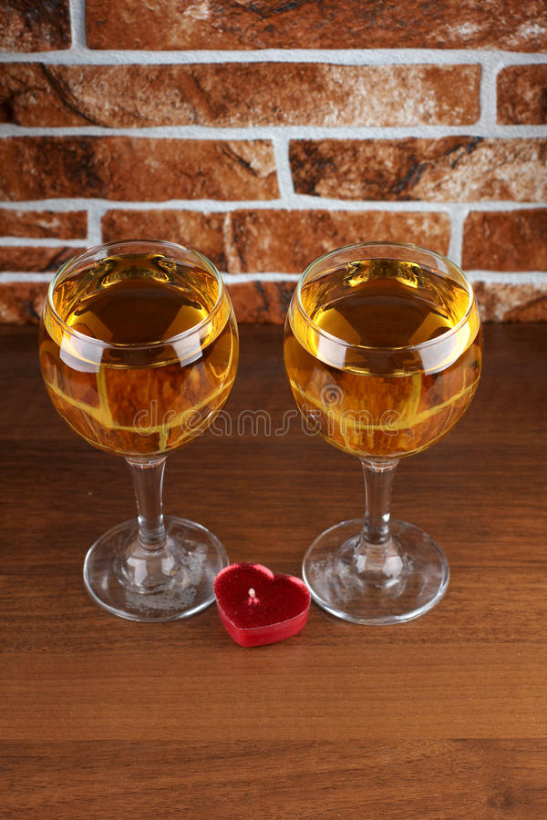 Two glass on table. Glass and bottle wine on wooden table royalty free stock images