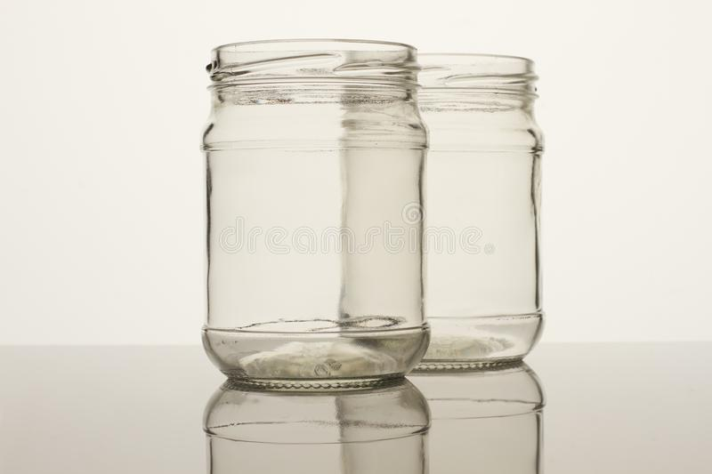Two glass transparent empty jars. royalty free stock images