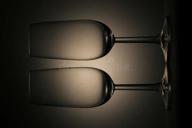 Two glasses. ALCOHOL, BAR, COFFEE, DRINKING, PARTY, BEVERAGE, GLASS, EVENING, BLACK, WHITE, CHAMPAGNER, PAIR, TWO, marrige, ROMANIC royalty free stock photo