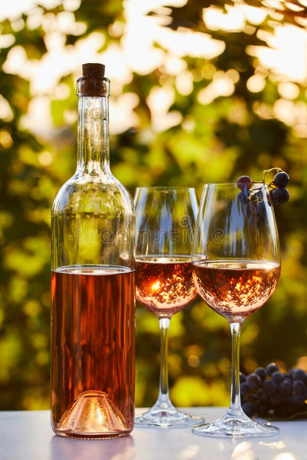 Free Two Glasses And A Bottle Of Rose Wine Stock Photo - 199334720