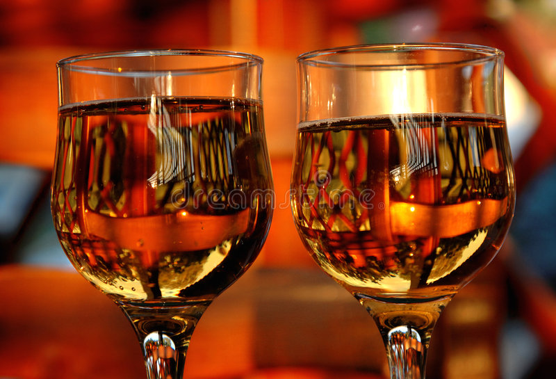 Two Glasses In A Bar. At sunset, reflecting a pictorial like image effect stock images