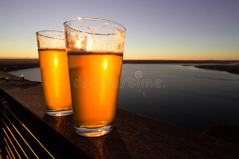 Two glasses of beer. At the patio stock photo