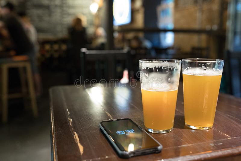 Two glasses of beer in a pub. Two glasses of delicious beer in a pub trip, alcohol, bar, lager, drink, celebration, restaurant, beverage, brewery, ale, cold stock photography