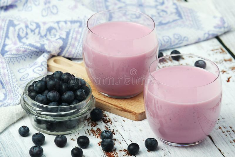 Two glasses with blueberry yogurt stock image