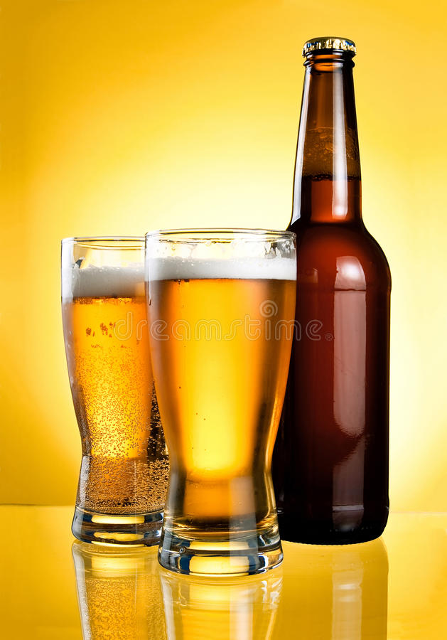 Download Two Glasses And Bottle Of Fresh Light Beer Royalty Free Stock Photography - Image: 25009677