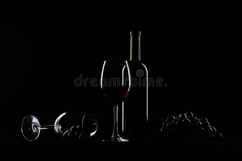 Two glasses, bottle of wine and grapes stock photo
