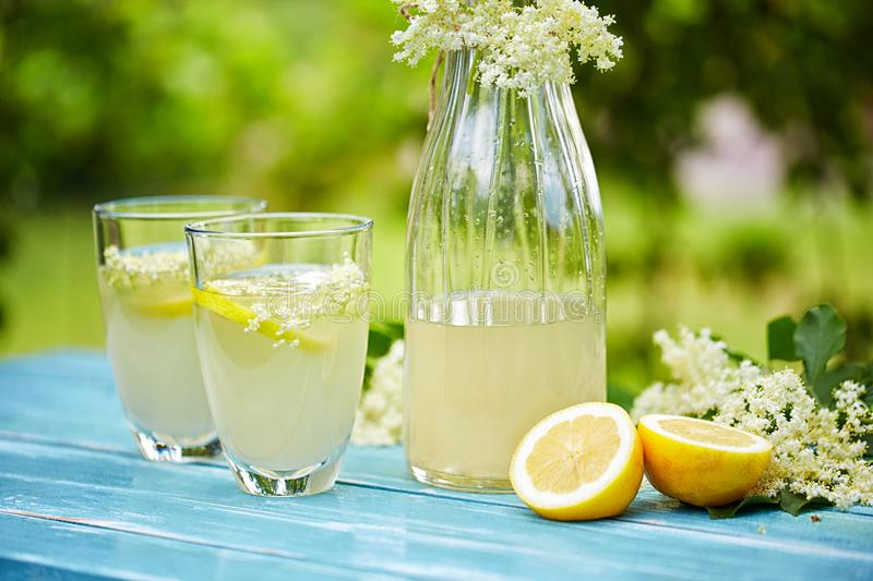 Two glasses and a carafe of elderflower lemonade. On table royalty free stock image