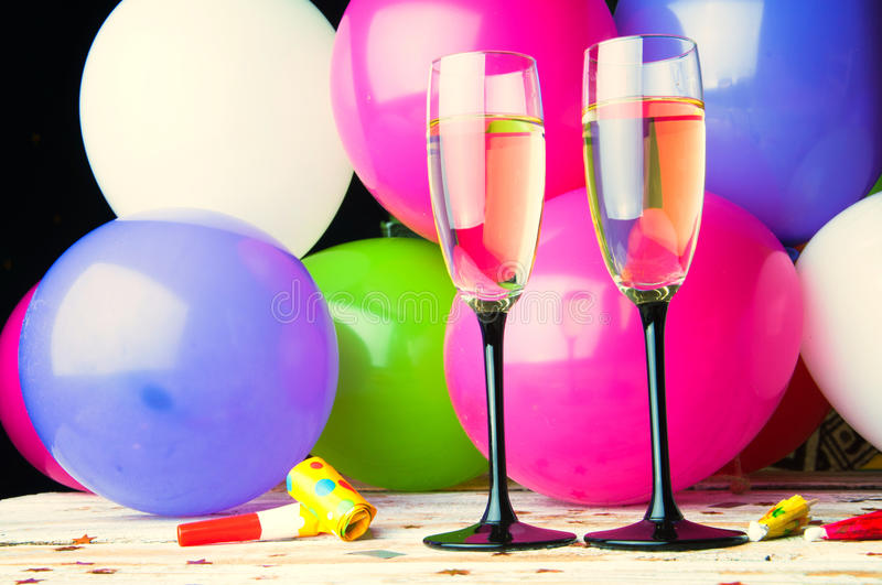Two glasses of champagne and balloons on party stock photos