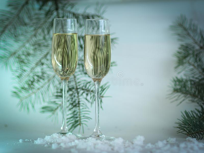 Two glasses with champagne, and boxes with gifts on Christmas b royalty free stock images