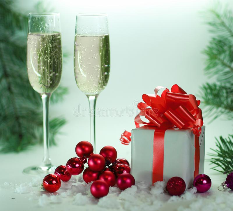 Two glasses with champagne, and boxes with gifts on Christmas ba stock photos