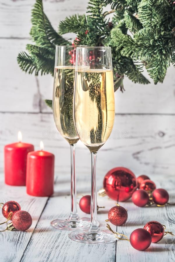 Two glasses of champagne with Christmas tree stock image