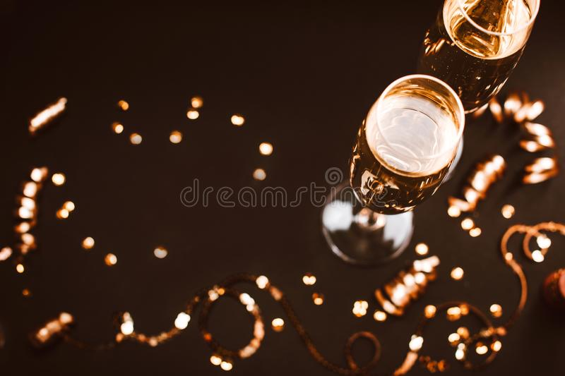 Two glasses of champagne with decoration on black elegant background. stock photo