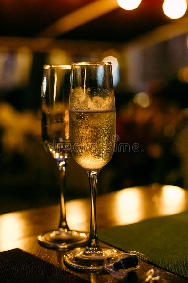 Two glasses champagne holiday background with garlands. Two glasses with champagne on a holiday background with garlands, fizz, christmas, new, year, celebrate stock photography