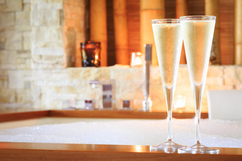 Two glasses of champagne near jacuzzi. Valentines background. Romance concept. Horizontal stock photography