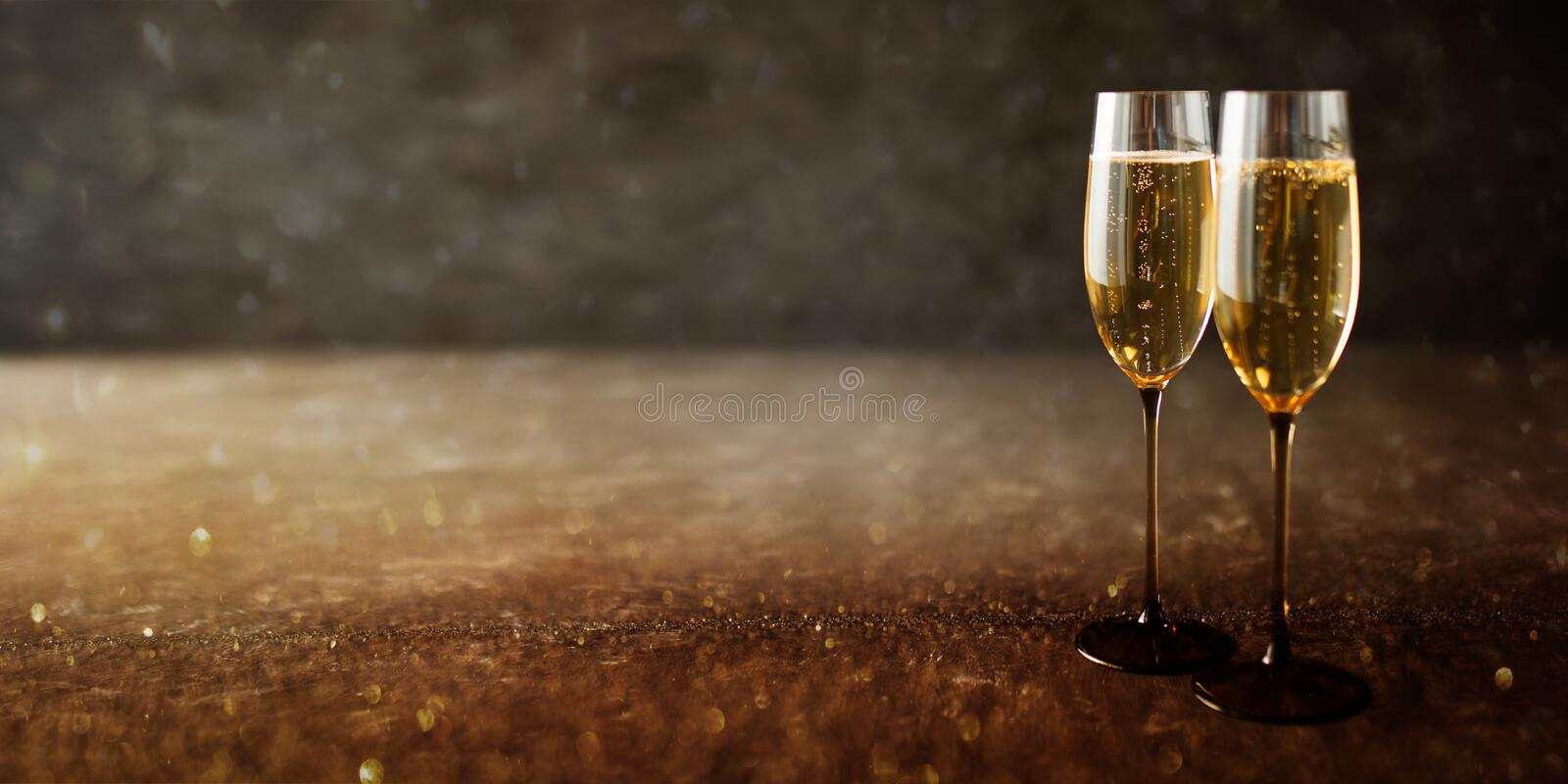 Champagne on old stone plate. Two glasses with champagne on old stone plate royalty free stock photo