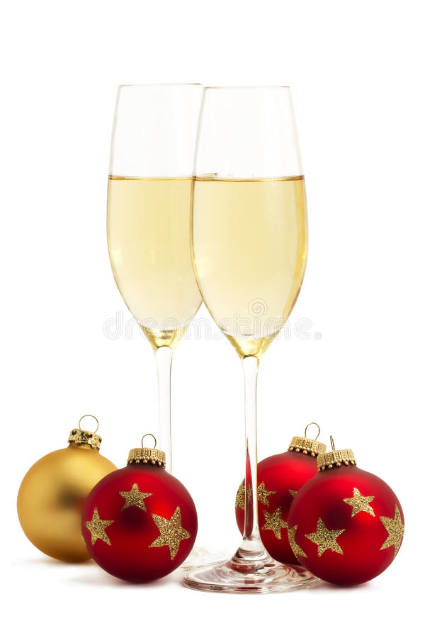 Two glasses with champagne with one golden and thr stock images