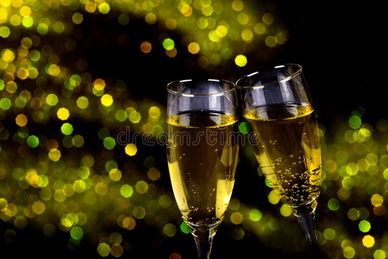 Two glasses of champagne with sparkling lights. Bokeh royalty free stock photography