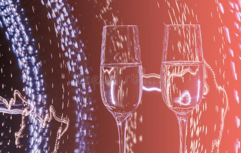 Two glasses of champagne wine on a background of abstract colored lights in motion in the natural color of the living coral stock image