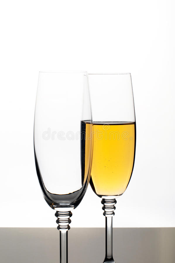 Two glasses of champagne or wine isolated on white royalty free stock photo