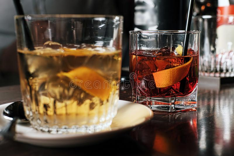 Two glasses of cocktail with orange slice. Toned image royalty free stock photos