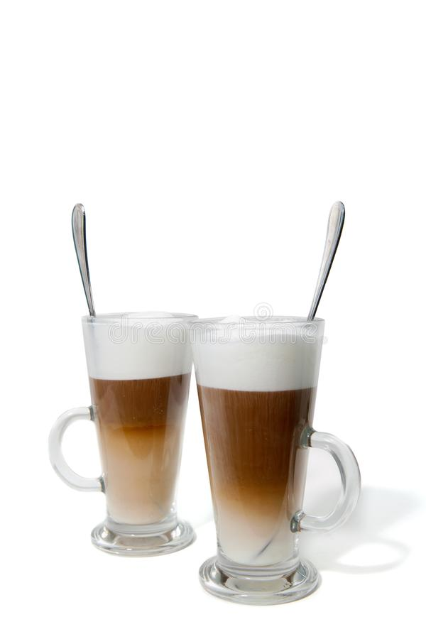 Two glasses of coffee with milk stock photography