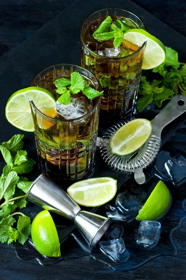 Cuba libre cocktail with rum, cola and lime, holidays party concept. royalty free stock photos