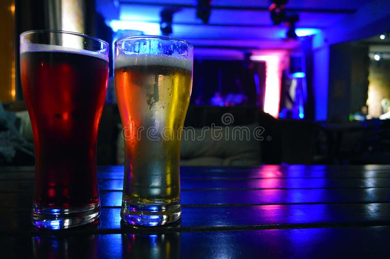 Two glasses of dark and light beer royalty free stock photography