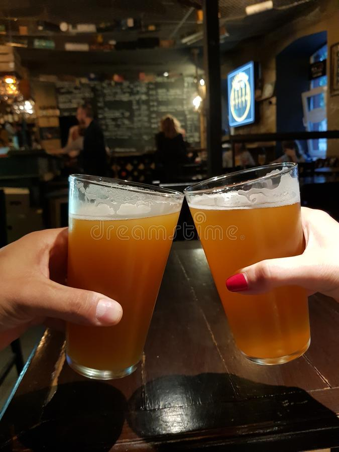 Two glasses of beer in a pub. Two glasses of delicious beer in a pub trip, alcohol, bar, lager, drink, celebration, restaurant, beverage, brewery, ale, cold royalty free stock photography