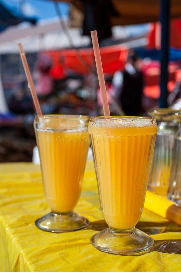 Two glasses of delicious, refreshing orange juice. royalty free stock image