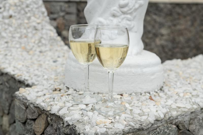 two glasses of delicious white wine on a granite surface royalty free stock photo