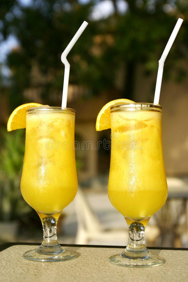 Two glasses of juice royalty free stock photos