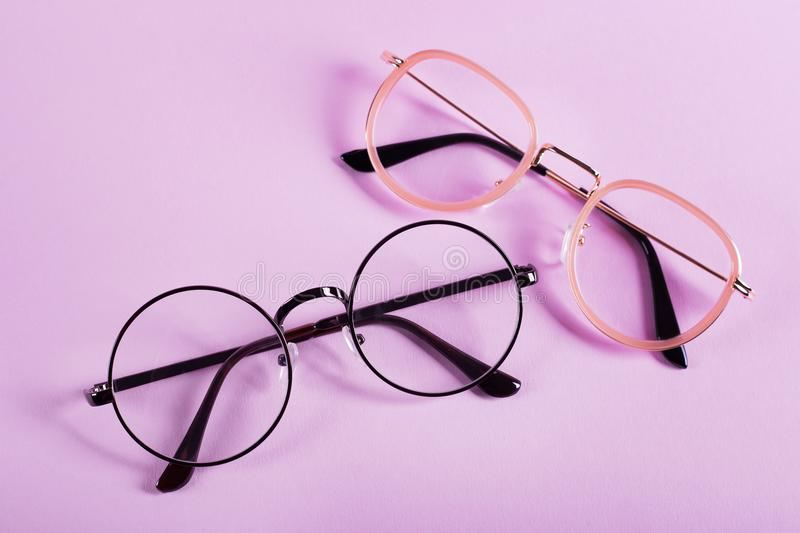 Two glasses on lilac background royalty free stock photos