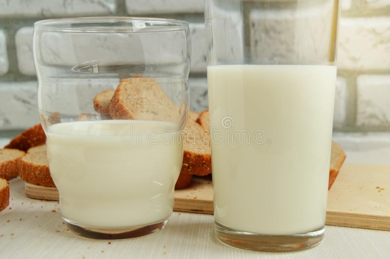Two glasses of milk are on the table, Breakfast for the family, healthy eating concept, world health day royalty free stock photo