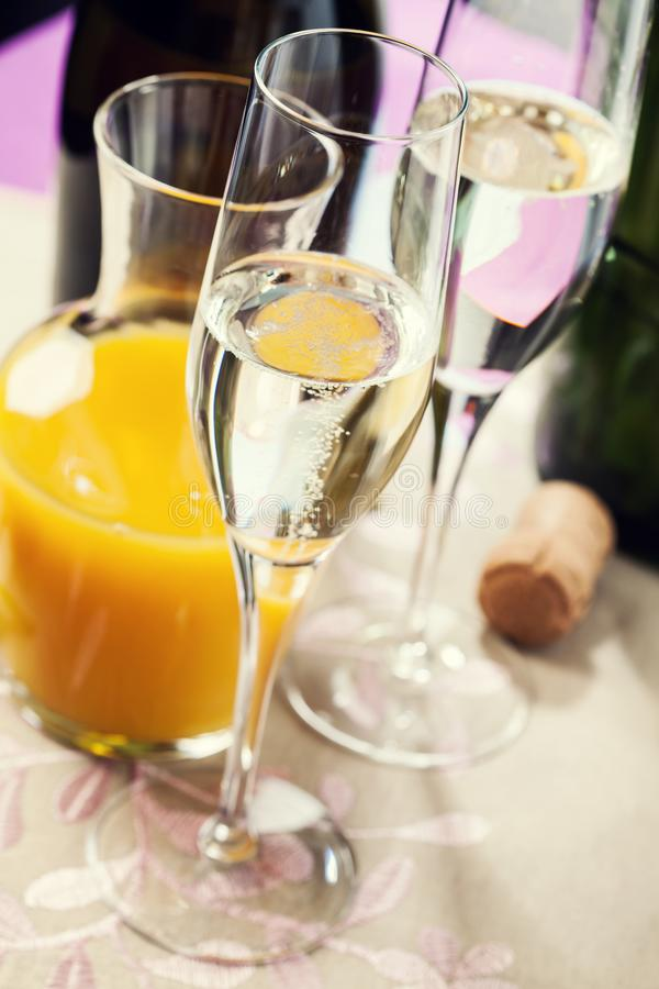 Two glasses of mimosa cocktail stock images
