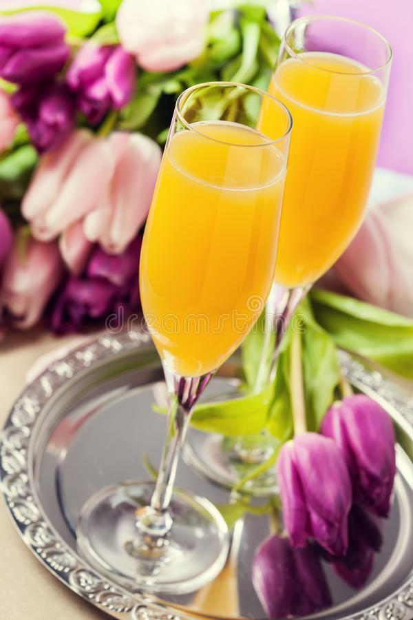 Two glasses of mimosa cocktail royalty free stock photo